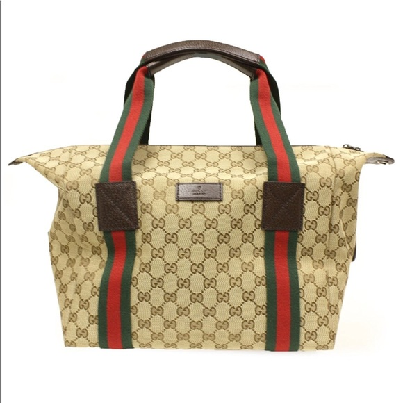 f692dc6ee96 Gucci Handbags - Gucci large beige ebony GG fabric carry on duffel